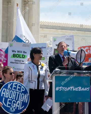 United States Representative Judy Chu (Democrat of California) and United States Senator Richard Blumenthal (Democrat of Connecticut) speak to demonstrators outside of the Supreme Court.