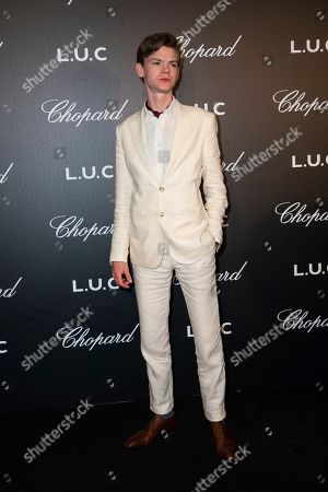 Stock Picture of Thomas Brodie-Sangster poses for photographers upon arrival at the Chopard Gentlemen evening at the 72nd international film festival, Cannes, southern France