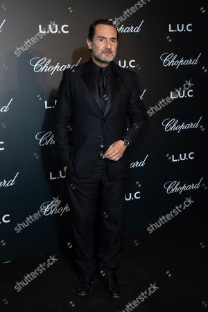 Stock Image of Gilles Lellouche poses for photographers upon arrival at the Chopard Gentlemen evening at the 72nd international film festival, Cannes, southern France