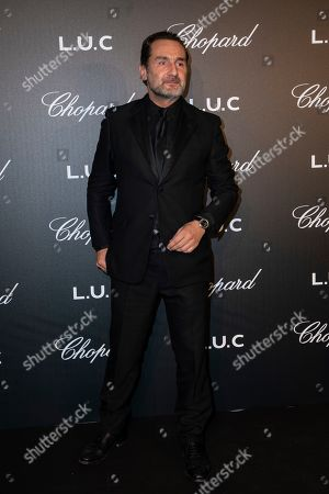 Stock Photo of Gilles Lellouche poses for photographers upon arrival at the Chopard Gentlemen evening at the 72nd international film festival, Cannes, southern France