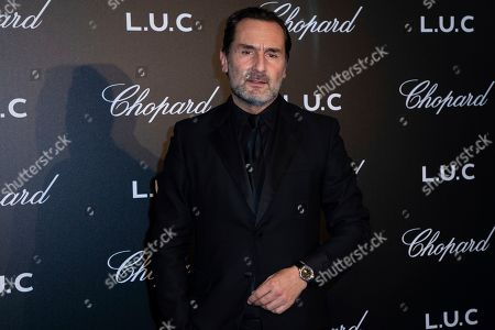 Stock Picture of Gilles Lellouche poses for photographers upon arrival at the Chopard Gentlemen evening at the 72nd international film festival, Cannes, southern France