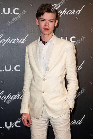 Stock Image of Thomas Brodie-Sangster poses for photographers upon arrival at the Chopard Gentlemen evening at the 72nd international film festival, Cannes, southern France