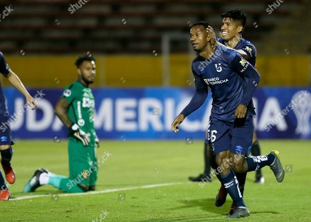 Stock Image of Walter Chala of Ecuador's Universidad Catolica, front, celebrates with his teammate Bruno Vides after he scored against Peru's Melgar during a Copa Sudamericana soccer match in Quito, Ecuador, . To the left is Carlos Caceda, goalkeeper of Peru's Melgar