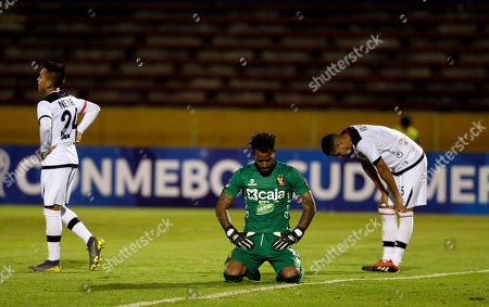 Stock Image of Carlos Caceda, goalkeeper of Peru's Melgar reacts after the sixth goal against his team during a Copa Sudamericana soccer match in Quito, Ecuador