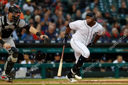 Stock Picture of Miami Marlins catcher Chad Wallach, left, reaches to tag Detroit Tigers' Christin Stewart on a dropped third strike in the fourth inning of a baseball game in Detroit, . Stewart was out at first base