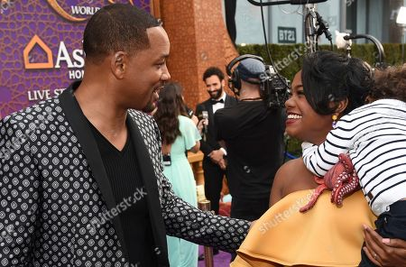"""Will Smith, Tatyana Ali. Will Smith, from left, greets Tatyana Ali and her son Edward as they arrive at the premiere of """"Aladdin"""", at the El Capitan Theatre in Los Angeles"""