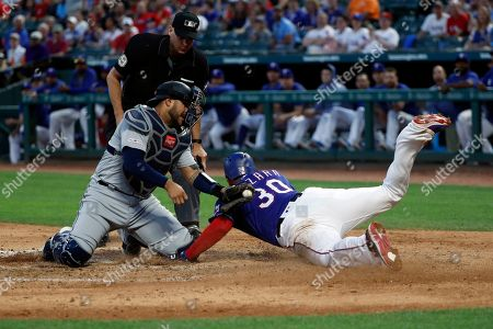 Nomar Mazara, Omar Narvaez, Andy Fletcher. Seattle Mariners catcher Omar Narvaez (22) attempts the tag as Texas Rangers' Nomar Mazara (30) scores on a sacrifice fly by Asdrubal Cabrera in the fourth inning of a baseball game in Arlington, Texas, . Umpire Andy Fletcher watches the play develop