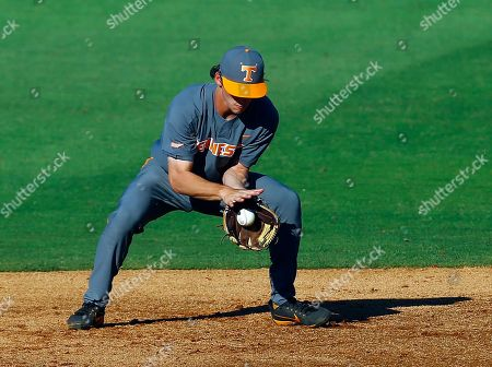 Tennessee second baseman Jake Rucker fields ground ball from Auburn's Will Holland (not pictured) during the second inning of the Southeastern Conference tournament NCAA college baseball game, in Birmingham, Ala