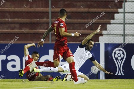 Daniel Munoz (L) and Jonathan Lopera (C) of Rionegro Aguilas in action against Gaston Silva (R) of Independiente during the Copa Sudamericana second phase soccer match between Rionegro Aguilas and Independiente at the Alberto Grisales Stadium in Rionegro, Colombia, 21 May 2019.