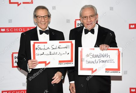Robert Caro, Bob Woodward. Author Robert Caro, left, and PEN literary service award recipient Bob Woodward pose together holding signs in support of jailed Saudi women's rights activists Nouf Abdulaziz, Loujain Al-Hathloul and Eman Al-Nafjan at the 2019 PEN America Literary Gala at the American Museum of Natural History, in New York