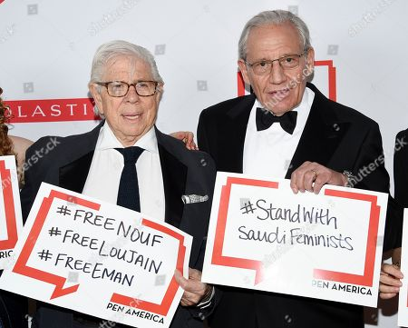 Carl Bernstein, Bob Woodward. PEN literary service award recipient Bob Woodward, right, poses with fellow journalist and author Carl Bernstein holding signs in support of jailed Saudi women's rights activists Nouf Abdulaziz, Loujain Al-Hathloul and Eman Al-Nafjan at the 2019 PEN America Literary Gala at the American Museum of Natural History, in New York