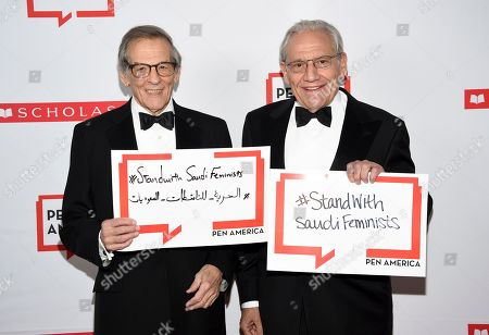 Stock Picture of Robert Caro, Bob Woodward. Author Robert Caro, left, and PEN literary service award recipient Bob Woodward pose together holding signs in support of jailed Saudi women's rights activists Nouf Abdulaziz, Loujain Al-Hathloul and Eman Al-Nafjan at the 2019 PEN America Literary Gala at the American Museum of Natural History, in New York