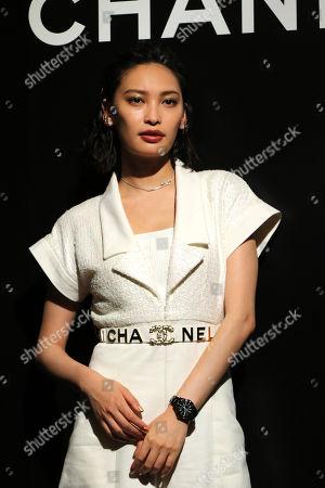 Aya Omasa displays the newly designed wristwatch 'J12'