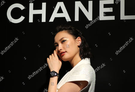 Stock Picture of Aya Omasa displays the newly designed wristwatch 'J12'