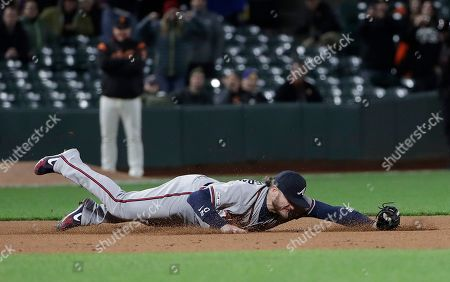 Atlanta Braves third baseman Josh Donaldson fields the ball on a base hit by San Francisco Giants' Pablo Sandoval during the ninth inning of a baseball game in San Francisco