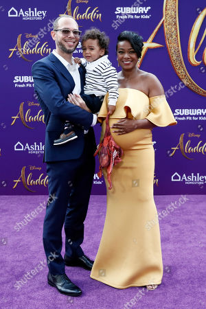 Tatyana Ali (R), her husband Vaughn Rasberry (L) and their son Edward Aszard Rasberry (C) pose on the red carpet during Disney's 'Aladdin' movie premiere at the El Capitan Theatre in Hollywood, California, USA, 21 May 2019. The movie opens in US theaters on 24 May 2019.