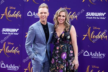 Justin Paul (L) and his wife Asher Fogle Paul (R) pose on the red carpet during Disney's 'Aladdin' movie premiere at the El Capitan Theatre in Hollywood, California, USA, 21 May 2019. The movie opens in US theaters on 24 May 2019.