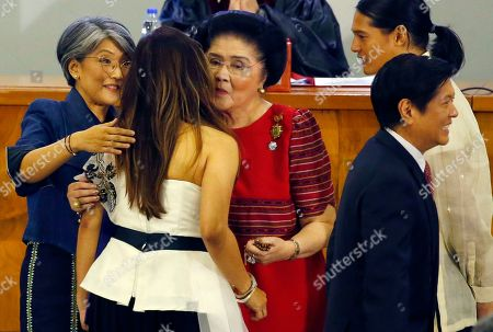 """Imee Marcos, Imelda Marcos, Irene Marcos-Araneta, Ferdinand """"Bongbong"""" Marcos Jr., Fernando Martin """"Borgy"""" Marcos Manotoc. Newly-elected Senator Imee Marcos, back to camera, is congratulated by her mother former first lady Imelda Marcos, center, and sister Irene Marcos-Araneta following proclamation ceremony in suburban Pasay city, south of Manila, Philippines . The Philippine president's allies won a majority of the 12 Senate seats at stake in the May 13 midterm elections while the opposition's shutout heralds a stronger grip on power by a leader accused of massive human rights violations. At right in foreground is her brother Ferdinand """"Bongbong"""" Marcos Jr., and her son Fernando Martin """"Borgy"""" Marcos Manotoc. The Marcoses ruled the country for 20 years until they were ousted via a """"People Power Revolution"""" in 1986"""