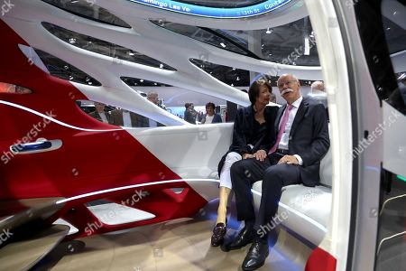 Daimler AG CEO Dieter Zetsche (R) and his wife Anne Zetsche sit in a car during the Daimler AG annual general meeting (AGM) in Berlin, Germany, 22 May 2019. Daimler shareholders are gathering for the annual shareholders' meeting.