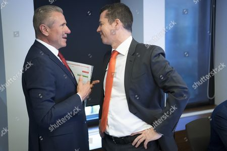 Stock Photo of International Olympic Committee (IOC) member Ukrainian Sergei Bubka (C) speaks with International Olympic Committee (IOC) Sports Director Kit McConnell during the opening of the executive board meeting of the IOC at committee's headquarters in Pully, Switzerland, 22 May 2019.