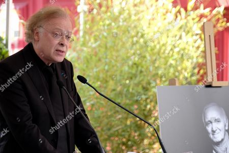 Stock Picture of Erik Berchot, pianist who worked with Charles Aznavour, gave a speech at the tribute.