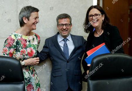 EU Commissioner for Competition Margrethe Vestager from Denmark (L), Commissioner responsible for Research, Science and Innovation, Portuguese Carlos Moedas (C) and European Commissioner for Trade Cecilia Malmstrom attend the weekly College Meeting of the European Commission in Brussels, Belgium, 22 May 2019.
