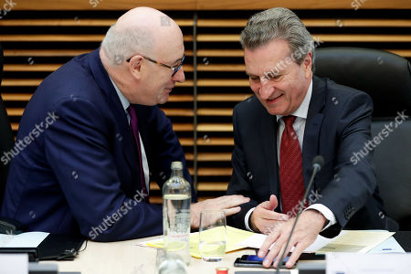 European Commissioner for Agriculture and Rural Development Irish Phil Hogan (L) and EU Budget Commissioner, German Gunther Oettinger attend the weekly College Meeting of the European Commission in Brussels, Belgium, 22 May 2019.