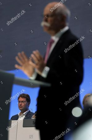 Incoming Daimler CEO Ola Kaellenius, rear, attends the speech of Daimler CEO Dieter Zetsche, right, during the annual shareholder meeting of the car manufacturer Daimler in Berlin, Germany