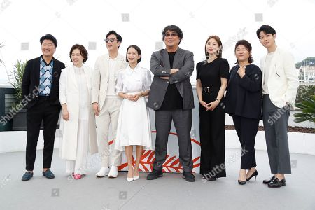 Bong Joon-ho (4-R) poses with South Korean actors Kang-Ho Song, Chang Hyae-Jin, Lee Sun-kyun, Cho Yeo-jeong, Park So-dam, Lee Jung-Eun and Choi Woo-shik during the photocall for 'Parasite' at the 72nd annual Cannes Film Festival, in Cannes, France, 22 May 2019. The movie is presented in the Official Competition of the festival which runs from 14 to 25 May.