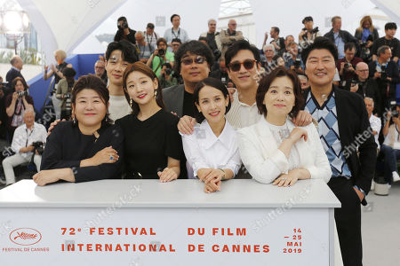 South Korean actress Lee Jung-Eun, South Korean actor Choi Woo-Shik, South Korean actress Park So-dam, South Korean director Bong Joon-ho, South Korean actress Cho Yeo-Jeong, South Korean actor Lee Sun-kyun, South Korean actress Chang Hyae-Jin and South Korean actor Kang-Ho Song pose during the photocall for 'Parasite' at the 72nd annual Cannes Film Festival, in Cannes, France, 22 May 2019. The movie is presented in the Official Competition of the festival which runs from 14 to 25 May.