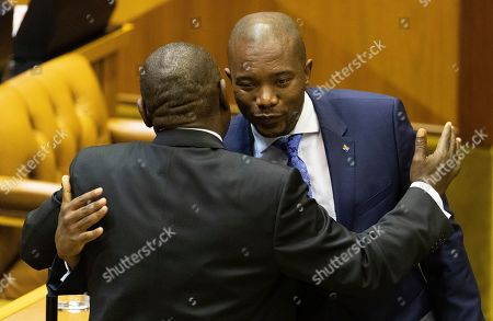 South African president Cyril Ramaphosa (L) is congratulated by Leader of the opposition Mmusi Maimane (R) of the Democratic Alliance (DA) after being elected president of South Africa during the swearing in of new members of the National Assembly and election of the National Assembly speaker and election of president in Parliament, Cape Town, South Africa 22 May 2019. This is the first sitting of parliament following the 2019 general elections making this the 6th parliament since the fall of apartheid.