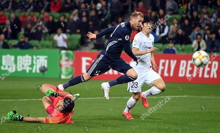 Stock Picture of Ola Toivonen of the Victory (C) and Takuto Hayashi of Hiroshima (L) in action during the AFC Champions League Group F match between the Melbourne Victory and the Sanfrecce Hiroshima at AAMI Park in Melbourne, 22 May 2019.