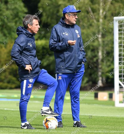 Chelsea's manager Maurizio Sarri (R) and assistant Gianfranco Zola (L)  attend a training session during a Chelsea media day at Chelsea's training ground in Cobham, south east of London, Britain, 22 May 2019. Chelsea play Arsenal in the UEFA Europa League final soccer match in Baku on 29 May 2019.