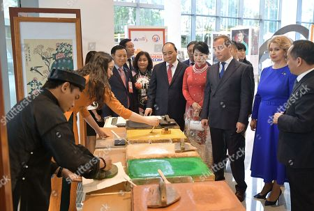 Russian Prime Minister Dmitry Medvedev (3-R) and his wife Svetlana Medvedeva (2-R), Vietnamese Prime Minister Nguyen Xuan Phuc (5-R) and his wife Tran Nguyet Thu (4-R) visit an exhibition as part of the Cross Years of Russia and Vietnam at the Zaryadye concert hall in Moscow, Russia, 22 May 22 2019. Vietnamese Prime Minister is on a four-day official visit to Russia.