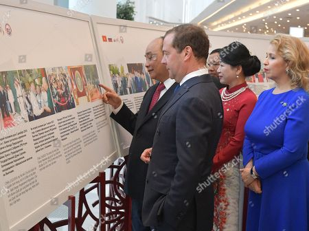 Russian Prime Minister Dmitry Medvedev (2-L) and his wife Svetlana Medvedeva (R), Vietnamese Prime Minister Nguyen Xuan Phuc (L) and his wife Tran Nguyet Thu (2-R) visit an exhibition as part of the Cross Years of Russia and Vietnam at the Zaryadye concert hall in Moscow, Russia, 22 May 22 2019. Vietnamese Prime Minister is on a four-day official visit to Russia.