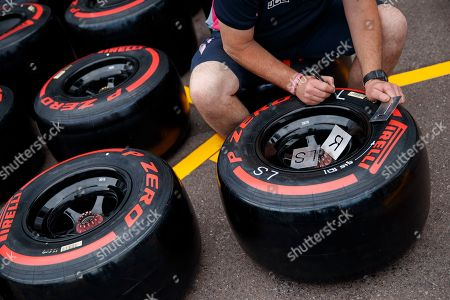 Stock Image of A Mechanic of Racing Point marks tyres at the Monte Carlo circuit in Monaco, 22 May 2019. The 2019 Formula One Grand Prix of Monaco will take place on 26 May 2019.