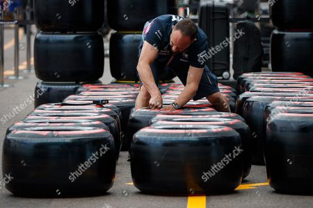 A Mechanic of Racing Point marks Formula One tyres at the Monte Carlo circuit in Monaco, 22 May 2019. The 2019 Formula One Grand Prix of Monaco will take place on 26 May 2019.