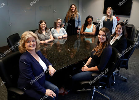 Business owner Meloney Perry, left front, poses for a photo with members of her staff, Karla Roush, from left rear, Lisa Amerson, Michelle Smith, Lauren Pickett, Samantha Doherty, Stacy Thompson and Brooke Bailey, right front, at her law firm in Dallas. Small business owners are making their company culture a bigger priority as they respond to the dramatically different expectations of a younger work force and a low unemployment rate that makes it harder to find staffers