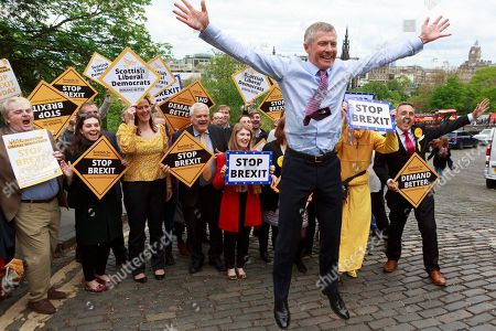 Willie Rennie attends a rally with activists and campaigners