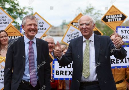 Liberal Democrat Leader Vince Cable and Willie Rennie attend a rally with activists and campaigners