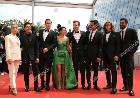 Nancy Grant, Antoine-Olivier Pilon, Catherine Brunet, Pier-Luc Funk, Gabriel d'Almeida Freitas, Samuel Gauthier, Adib Alkhalidey. Actress Nancy Grant, from left, director Xavier Dolan, actors Antoine-Olivier Pilon, Catherine Brunet, Pier-Luc Funk, Gabriel d'Almeida Freitas, Samuel Gauthier and Adib Alkhalidey pose for photographers upon arrival at the premiere of the film 'Matthias and Maxime' at the 72nd international film festival, Cannes, southern France