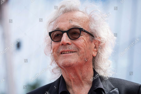 Lyricist Luc Plamondon poses for photographers upon arrival at the premiere of the film 'Matthias and Maxime' at the 72nd international film festival, Cannes, southern France