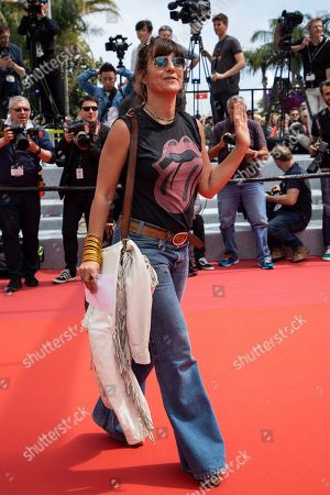 Romane Bohringer poses for photographers upon arrival at the premiere of the film 'Matthias and Maxime' at the 72nd international film festival, Cannes, southern France