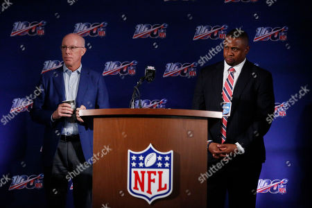 Falcons President and CEO, Rich McKay, left, and Troy Vincent, Executive Vice President of Football Operations, right, speak to the media during the NFL football owners meeting, in Key Biscayne, Fla
