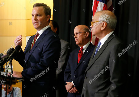 """Richard Culle, Ben Hatch, Richard Homan. Attorney for McGuire Woods law firm, Ben Hatch, left, gestures as McGuire Woods partner, Richard Cullen, right, and Dean of EVMS School of Medicine, Richard Homan, center, listen during a news conference, in Norfolk, Va., on a report announcing the results of an investigation into a blackface photo that appeared on the yearbook page of Virginia Gov. Ralph Northam from his Eastern Virginia Medical School yearbook. Investigators with the McGuire Woods law firm hired by Eastern Virginia Medical School said Wednesday they couldn't """"conclusively determine"""" the identities of either person in the 35-year-old photo"""