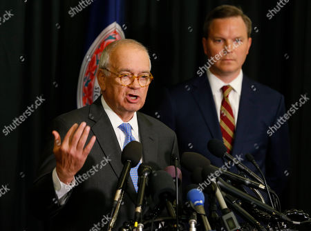 Richard Cullen, Ben Hatch. McGuire Woods law firm partner, Richard Cullen, left, gestures as Ben Hatch, right, listen during a news conference on a report announcing the results of an investigation into a blackface photo that appeared on the yearbook page of Virginia Gov. Ralph Northam from his Eastern Virginia Medical School yearbook in Norfolk, Va., . An investigation ordered up by Eastern Virginia Medical School failed to determine whether Gov. Ralph Northam is in a 1984 yearbook photo of a man in blackface next to someone in a Ku Klux Klan hood