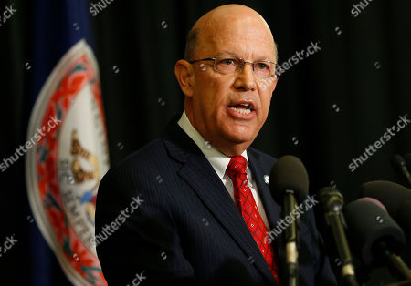 """Stock Photo of Richard Homan, Dean of EVMS School of Medicine, speaks during a news conference, in Norfolk, Va., about a report announcing the results of an investigation into a blackface photo that appeared on the yearbook page of Virginia Gov. Ralph Northam from his Eastern Virginia Medical School yearbook. Investigators with the McGuire Woods law firm hired by EVMS said Wednesday they couldn't """"conclusively determine"""" the identities of either person in the 35-year-old photo"""