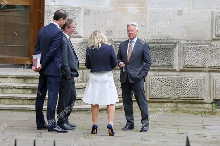 Sir Alan Duncan (R) Minister of State for Europe and the Americas and MP for Rutland and Melton is seen at the rear of Downing Street.