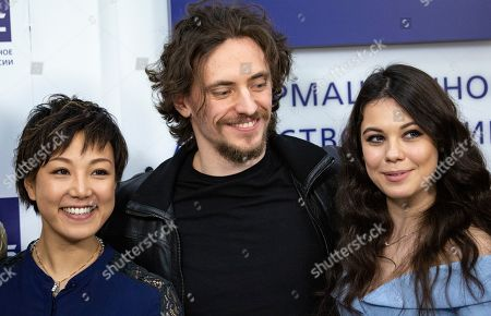 """Sergei Polunin, Elena Ilinyh, Yuka Oishi. International ballet star Sergei Polunin, center, Japanese dancer and choreographer Yuka Oishi, left, and dancer Elena Ilinyh pose for a photo after a news conference in Moscow, Russia, . Polunin talked about his plans to perform in a new mixed program at the London Palladium theater, including world premiere of the drama ballet """"Rasputin"""