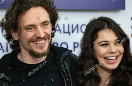 """Sergei Polunin, Elena Ilinyh. International ballet star Sergei Polunin and dancer Elena Ilinyh pose for a photo after a news conference in Moscow, Russia, . Polunin talked about his plans to perform in a new mixed program at the London Palladium theater, including world premiere of the drama ballet """"Rasputin"""